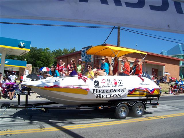 The Belles with a Marine Outlet Hurricane boat float during the Belton 4th July