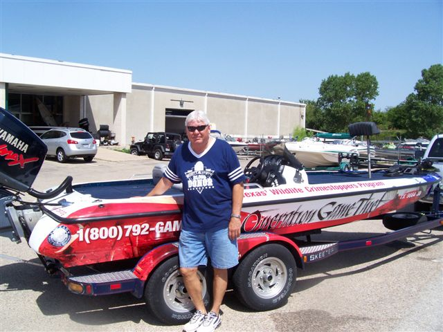 Billy Conway with his Operation Game Thief wrapped Skeeter Bass Boat